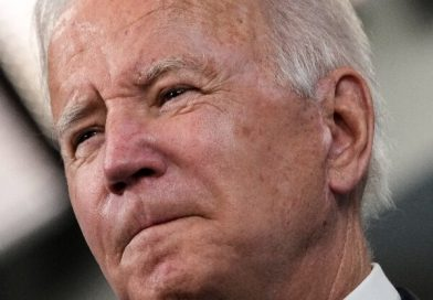 Biden Reassures Progressives on Cuts to Spending Bill